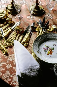 Louis XV vermeil flatware and crystal, linen napkins and Meissen china, await the attention of Karl Lagerfeld's staff.