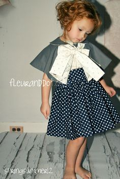Girls Grey Bow Cape with Peter Pan Collar: The Voyager Cape from the Spring Summer Collection by Fleur and Dot. $62.00, via Etsy.