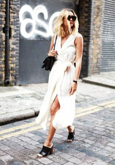 High slits accentuate the legs in a white wrap dress. // #StreetStyle
