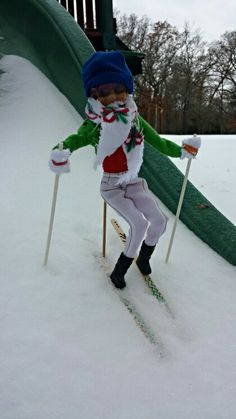 Elf on the Shelf skiing. I love his outfit. He really looks warm and having fun....