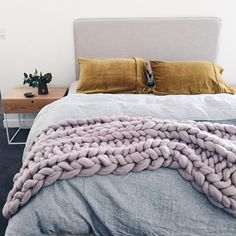 Fringed linen bedhead by Grazia and Co, Vintage washed linen doona cover Adairs, velvet pillow slips Kip and Co, chunky merino throw by Closely Knit, bedside tables Globe West.