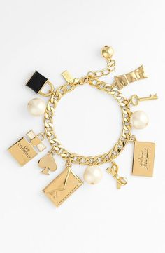 """A delightful assortment of signature baubles swing from a darling charm bracelet. 8 1/4"""" length. Lobster clasp closure. 12k-gold plate/enamel/plastic faux pearl. By kate spade new york.."""