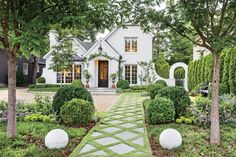 Pretty little white cottage home! Love the walkway detail and landscaping. Southern Home Exterior Ideas with Old Southern Charm White Exterior Paint, Exterior Paint Colors, Landscape Design, Garden Design, Landscape Elements, Patio Design, White Brick Houses, Dream House Exterior, House Exteriors