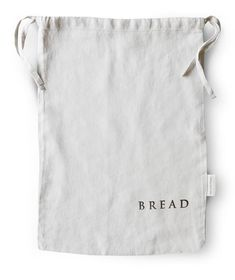 Dove Grey Linen Bread Bag | Fork + Rose: Home and Table Decor. Our Linen Bread Bag is a contemporary take on classic French design, woven from pure European flax and hand stamped in London. A simple drawstring pulls to a close to keep your bread fresh and endlessly moreish.
