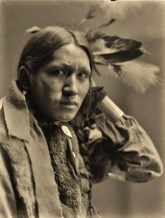 Photo taken in 1900 of Plenty Wounds of the Ogala Sioux Indian tribe..*