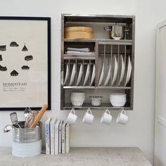 Stainless steel wall mounted plate racks. Different shapes and sizes available.