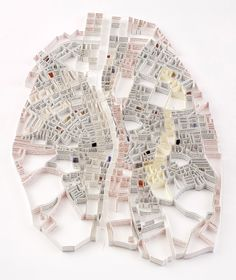 Cartographic Paper Sculptures - Matthew Picton is a UK-based artist who uses strips of paper from both historic and fictional texts to assemble maps from around the world.