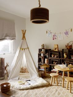 natural inspired play area - love the twine and clothespin to hang artwork and the woodland animals