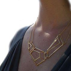 Architectural Structure Geometric Golden Necklace. $140.00, via Etsy.