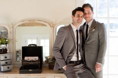 A stylish same-sex wedding inspiration shoot with two grooms and a lavender and gray color palette.