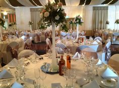 All white wedding reception decor at the grand ballroom adelaide tall glass centerpieces for adelaide wedding reception houseofthebride junglespirit Image collections