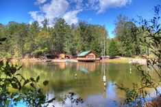 Knott's Landing | Cabin Rentals of Helen Cabin Rentals, Vacation Rentals, Helen Ga Cabins, John Boats, Paddle Boat, Small Lake, Cozy Cabin, Canoe, Perfect Place