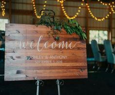 Lights add such a romantic touch to any wedding! We also LOVE this Welcome sign!