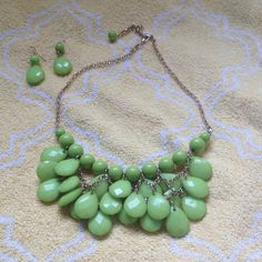 Lime green earring and necklace set Lime green dangly earring and tiered necklace set with gold chain and clasps, worn once Jewelry Necklaces