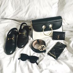 Designer Accessories worth buying that go with everything from classic Gucci slingback loafers to the Gucci Belt, Celine Sunglasses, YSL card holder and J W Anderson black and white pierce bag - Shop here http://liketk.it/2qXIl - Follow my instagram for more outfit inspiration at http://www.instagram.com/lurchhoundloves