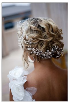 A wrap-around hair accessory gives detail from every angle!