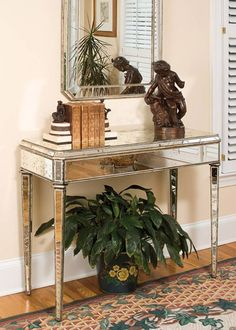 This Antique Mirrored Console Table Is Hand Finished And Constructed From  Wood That Is Finished With Hand Painted Silver Leafing And Aged Mirror.