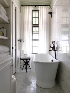 Good use of narrow bathroom.  Love the mosaics on the floor and the marble on the wall.