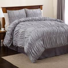 Love this Grey Comforter set.  Showcasing elegant rouched detailing, this 5-piece comforter set infuses your bed with a feminine touch.