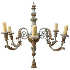 Six-Light Italian Carved Wood and Metal Chandelier | From a unique collection of antique and modern chandeliers and pendants  at https://www.1stdibs.com/furniture/lighting/chandeliers-pendant-lights/