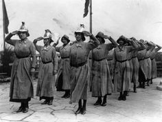 1916, The UK Women's Fire Brigade takes a salute.