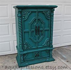 Vintage Armoire /Gypsy Teal / Bedroom Furniture/ Distressed /Black Drawer Pulls/ TV Stand/ Storage -Custom Paint to Order. $499.00, via Etsy.