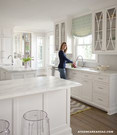 Donna Barnett Little Rock kitchen with green sea glass with an opalescent finish.