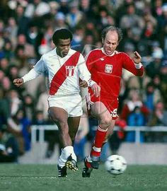 Poland 1 Peru 0 in 1978 in Mendoza. Teofilo Cubillas and Grzegorz Lato race for the ball in Round 2, Group B at the World Cup Finals.