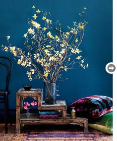 Bring drama to a large room using tall dogwood branches. The colourful blooms really bounce off a dark wall and displays beautifully in a room with rich colours and patterns.