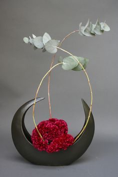 """Ikebana (""""living flowers"""") is the Japanese art of flower arrangement, also known as kadō (the """"way of flowers""""). More than simply putting flowers in a container, ikebana is a disciplined art form in which nature and humanity are brought together. Contrary to the idea of floral arrangement as a collection of particolored or multicolored arrangement of blooms, ikebana often emphasizes other areas of the plant, such as its stems and leaves, and draws emphasis toward shape, line, form."""