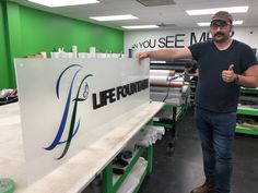 """Jeff is working on a new lobby sign with cut vinyl and dimensional letters on acrylic. It will be mounted with 1"""" standoffs at Life Fountain Home Health Care in St. Paul. Home Health Care, Lobbies, Sign Design, Minneapolis, Signage, Fountain, Letters, Life, Furniture"""