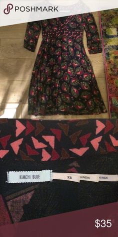 Great urban outfitters thanksgiving dress! Kimichi blue dress from urban outfitters. Size XS. Navy with pink, red, and blue pattern. Side zipper and 3/4 sleeves. Great for holidays! Great condition Urban Outfitters Dresses