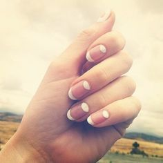 white and bare nail half moon manicure