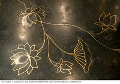 Terrazzo floor inlaid with brass water lilies at Rohit Bal's store in New Delhi, India