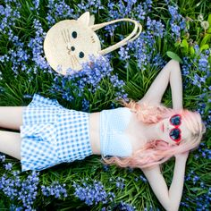 Daydreaming in the flowers  Wearing: Pixie Market skirt, Pepaloves bag, Her Tiny Teeth Sunglasses