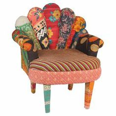 """Crafted from mango wood with a peacock-style back and vintage kantha cloth upholstery, this one-of-a-kind accent chair brings bright bohemian-inspired style to your decor.   Product: ChairConstruction Material: Vintage kantha cloth and mango woodColor: MultiFeatures: One-of-a-kindDimensions: 33"""" H x 29"""" W x 20"""" D"""