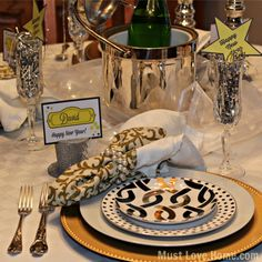 New Years Eve Table of Black, Gold and Silver is timeless elegance. Sheer fabric is lit f adding a gorgeous glow. Free printable place cards and Stars too! Printable Name Tags, Printable Place Cards, Free Printable, New Years 2016, New Years Eve, New Year Celebration, Love Home, Bright Lights, Timeless Elegance
