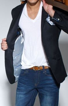 Guys if you shop right you can create this look actually for under $70. dark blazer | mid wash jeans | white v neck | tan belt| white and blue pocket square perfection. Men's Fashion
