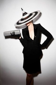 Black and white striped accessories to the extreme...Hat by Philip Treacy