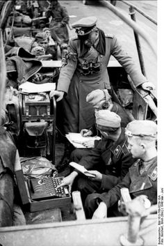 German General Heinz Guderian in a SdKfz. 251/3 halftrack vehicle, France, May 1940. Soldier is using Enigma machine.
