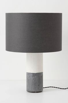 You *could* pay $898 for this concrete lamp from Anthropologie, OR you could go to the Home Depot, buy some QuickCrete, 2 PVC pipes (for molds), and lamp wire kit and make it yourself for around 20.00.  Buy the lampshade at Target for 15.00 and you've got yourself a savings of 850.00!!