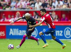 Neymar of FC Barcelona duels for the ball with Sergio Alvarez of Real Sporting de Gijon during the La Liga match between Real Sporting de Gijon and FC Barcelona at Estadio El Molinon on September 24, 2016 in Gijon, Spain.