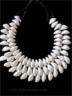 Elegantly Tribal - Contemporary Handcrafted Cowrie Shell Necklace from Burkina Faso in West Africa.