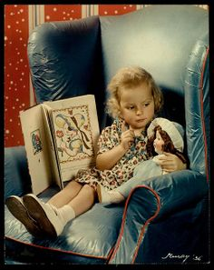 Wonderfully cute image from 1936 of a little girl reading to her dolly. #kids #vintage #photo #1930s #thirties #doll #children #ad