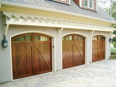 Western red cedar carriage doors with glass made by American Garage Door Systems, Inc Charlotte, NC