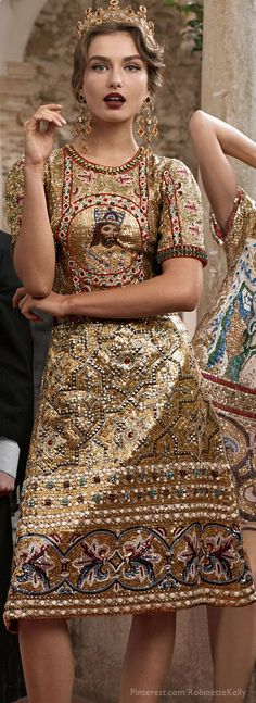"""Dolce &  Gabbana  Absolutely love the concept (Byzantine/Greek Orthodox Church/Medieval? ) but it's so badly done... The arm lenght and the skirt's tailoring just don't work well and the model's expression is should have been saucy but smart and  much more """"imperial""""."""