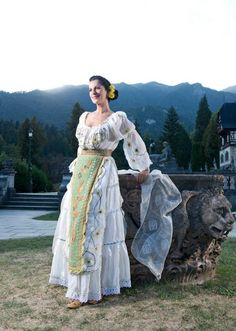 A beautiful shot of a traditional romanian costume in front of the Peles Castle. The costume belongs to Maria Dragomiroiu, one of the greatest Romanian Folk Singers. Folk Costume, Costumes, Peles Castle, Romanian Girls, What A Beautiful Day, Top Hairstyles, Folk Embroidery, Floral Fashion, Floral Crown