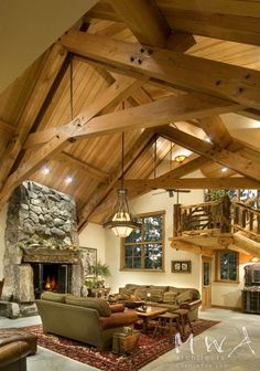 Love the wood beams, Stair case and fire place!! Log Cabin
