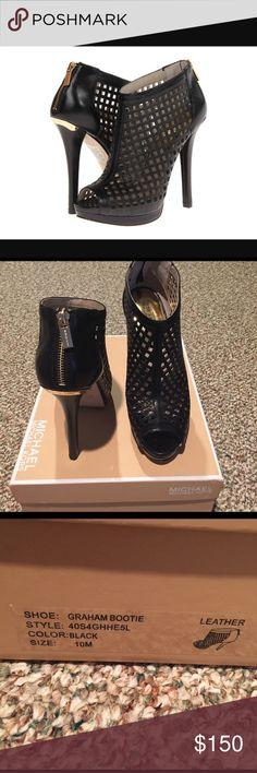 Michael Kors Graham Bootie Black cut out bootie. Worn once  size 10M MICHAEL Michael Kors Shoes Ankle Boots & Booties