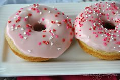 Forget Dunkin Donuts, make your own tasty Vanilla Bean Baked Donuts with Strawberry Frosting with this recipe from Shugary Sweets!